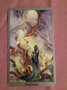 The Two of Swords from the Shadowscapes tarot.
